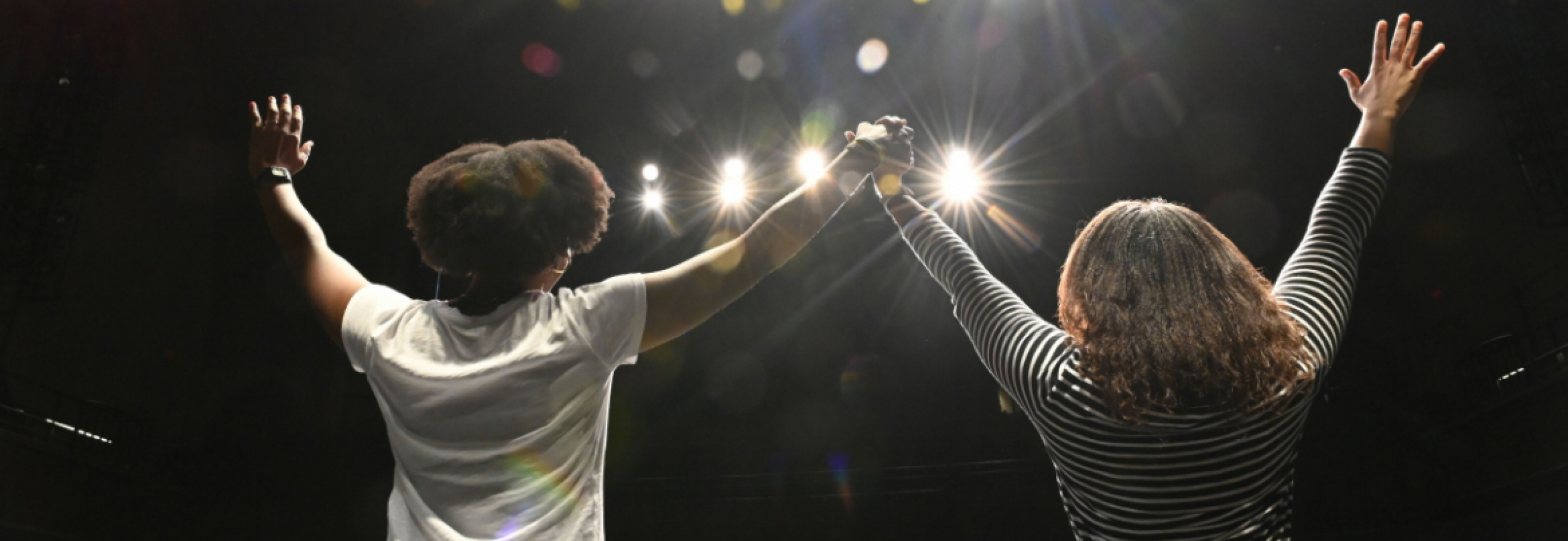 Inspiration image of two people on stage